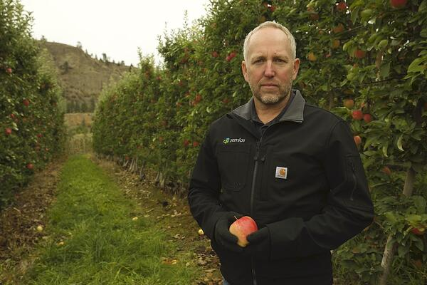 Semios CEO & Founder, Michael Gilbert in apple orchard